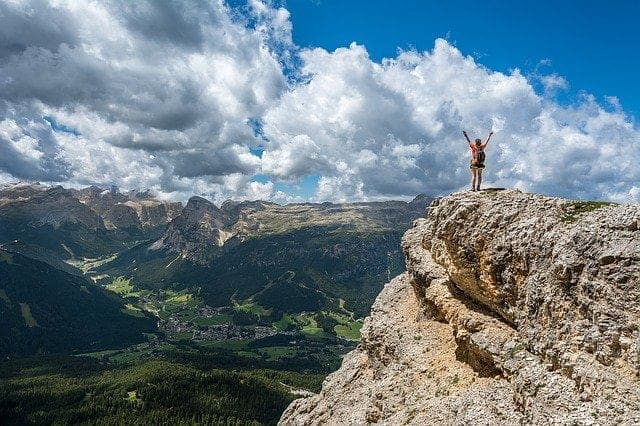 person-achieving-success-on-the-mountain-top