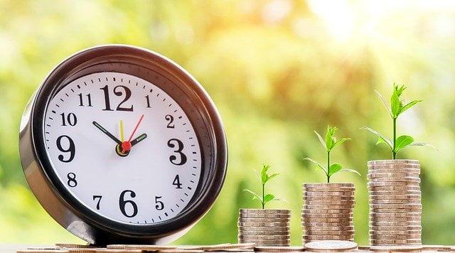Clock-next-to-money-plants