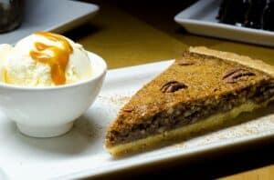 Texas pecan pie slice with ice cream courtesy of pixabay