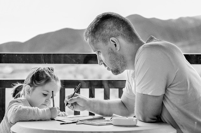 father-and-daughter-talking-over-papers