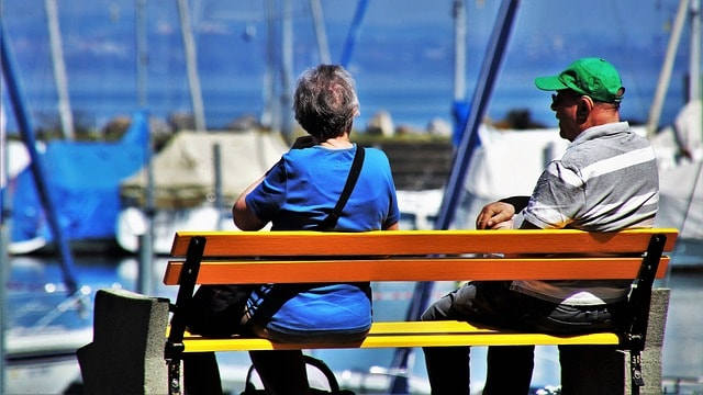 seniors-sitting-on-a-bench-by-the-water